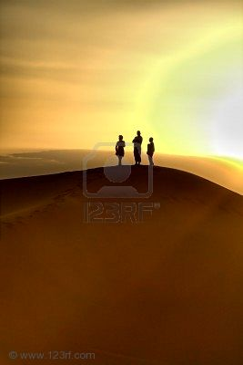 7698352-sunset-over-sand-dunes-poeple-are-not-identifable